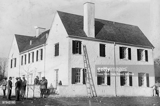 Police investigate baby kidnappng of Charles A Lindbergh Jr Ladder against side of house was a telltale sign of the time of baby kidnapping