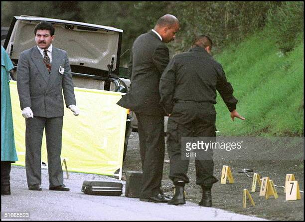 Police investigate evidence near the car of murder victim Enis Cosby the 28yearold son of entertainer Bill Cosby 16 January in Los Angeles CA Cosby...