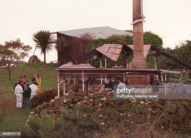 Police investigate in the ruins of the Seascape Guesthouse where gunman Martin Bryant retreated after shooting and killing 35 people at the Port...