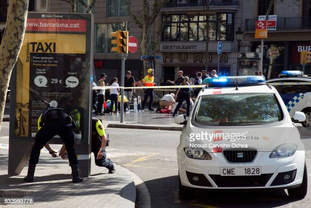Police investigate near the scene of a terrorist attack in the Las Ramblas area on August 17 2017 in Barcelona Spain Officials say 13 people are...