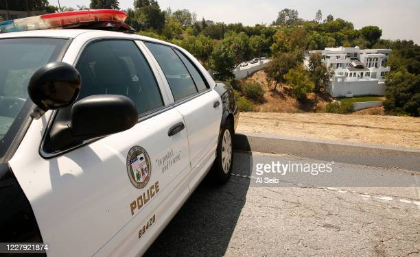 Police investigate the location of a huge home on 13200 Mulholland Drive in the Beverly Crest area of Los Angeles where gunfire erupted at a large...