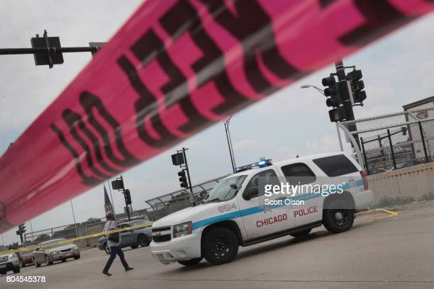 Police investigate the murder of a young man found shot to death in the back seat of a bulletriddled car on June 30 2017 in Chicago Illinois More...