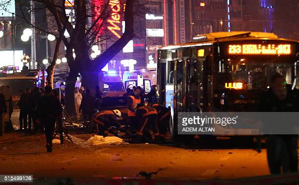 Police investigate the scene after a suicide car bomb ripped through a busy square in central Ankara on March 13 killing at least 34 people and...