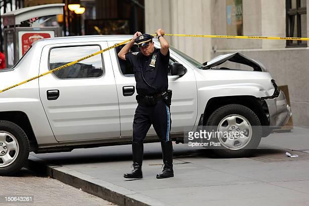 Police investigate the scene of a deadly truck crash in the financial district on August 23 2012 in New York United States The afternoon accident...