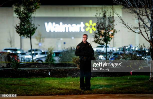 Police investigate the scene of a shooting at a Wal Mart store in the Thorton Town Center shopping plaza on November 1 2017 in Thornton Colorado...