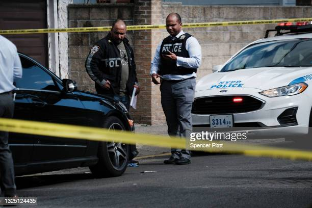 Police investigate the scene of a shooting in Brooklyn on June 23, 2021 in New York City. New Yorkers are increasingly concerned about a rise in...
