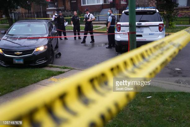 Police investigate the scene of a shooting in the Auburn Gresham neighborhood on July 21, 2020 in Chicago, Illinois. At least 14 people were...