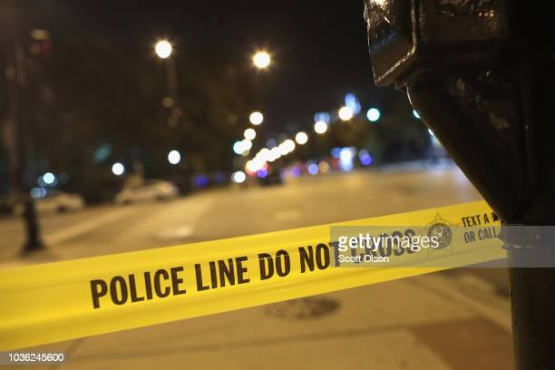 Police investigate the scene of a shooting near the Chinatown neighborhood where four people were shot in an apparent road rage incident on September...