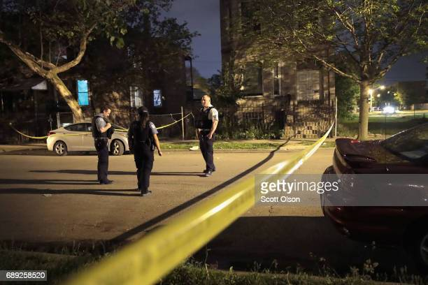 Police investigate the scene of a shooting on May 27 2017 in Chicago Illinois Chicago police have added more than 1000 officers to the streets over...