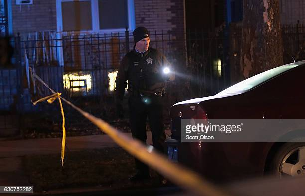 Police investigate the scene of a shooting where a 23yearold woman was shot in the chest and hand and a 25yearold man was shot in the leg on January...