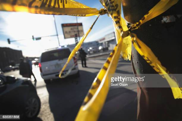 Police investigate the scene of a shooting where a two-year-old child, and a man in his twenties were killed and a pregnant woman was wounded in the...