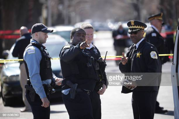 Police investigate the scene where a 16yearold was shot and killed on the 4800 block of Monroe Street in Chicago's South Austin neighborhood...