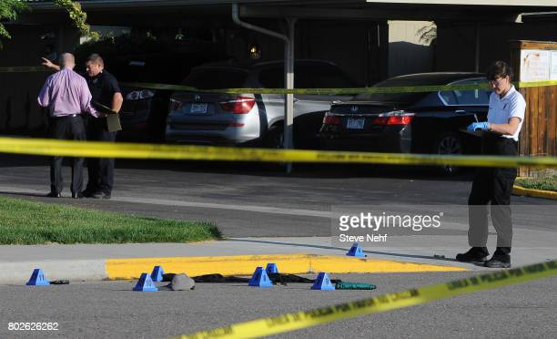 Police investigate the scene where a man died after being shot early Wednesday morning in southeast Denver Police found the man in the street near...