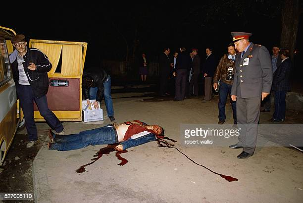 Police investigating a murder scene