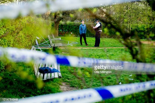Police investigating after a closed outdoor gym area at Primrose Hill with a Police tape covered fence and a sign explaining it is closed due to the...