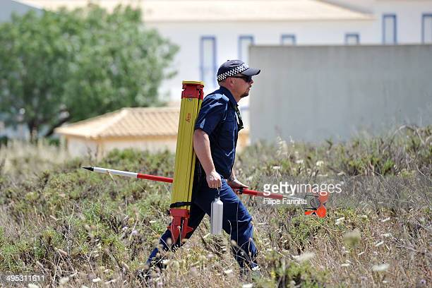 Police investigating the disappearance of Madeleine McCann search scrubland on June 2 2014 in Praia da Luz Portugal