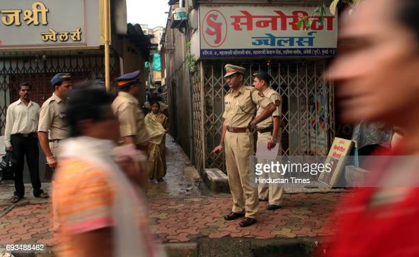 Police investigating the spot of the house where 39 years old women was murdered by three unknown person at Andheri Takshila on Thursday evening