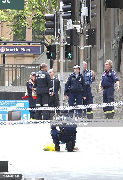 Police investigators collect evidence and mark the ground where evidence was found on December 16 2014 in Sydney Australia The siege in Sydney's...