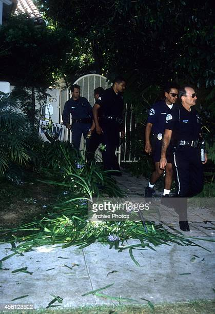 Police investigators look over the crime scene at the Brentwood condo after the bodies of Nicole Brown Simpson and Ron Goldman were found on June 13,...