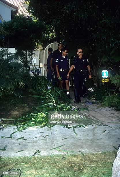 Police investigators look over the crime scene at the Brentwood condo after the bodies of Nicole Brown Simpson and Ron Goldman were found on June 13...