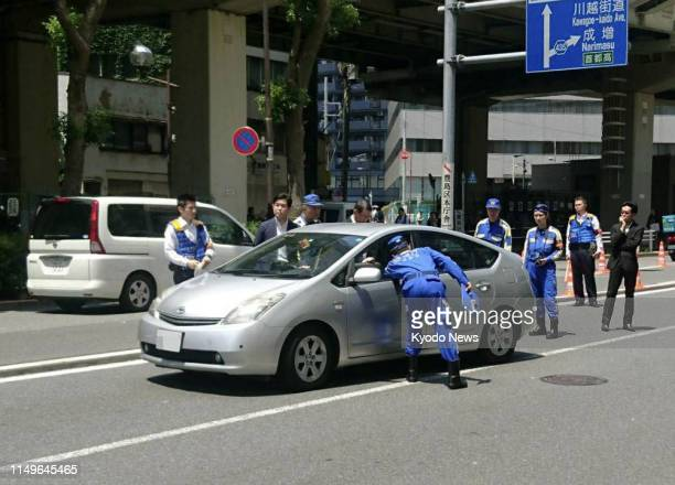 Police investigators recreate the circumstances of a fatal car accident in Tokyo's Ikebukuro district on June 13 in the presence of the driver...