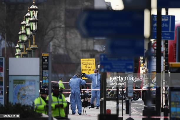 Police investigators seen on Westminster Bridge on March 22 2017 in London England A police officer was stabbed near to the British Parliament and...