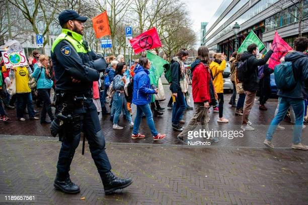 Police is accompanied the demonstration in support of the Urgenda case to the Tweede Kamer in The Hague on December 20th 2019