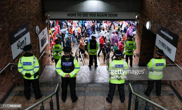 Police is seen as protestors take part in a large scale demonstration against austerity and the Conservative government on September 29 2019 in...