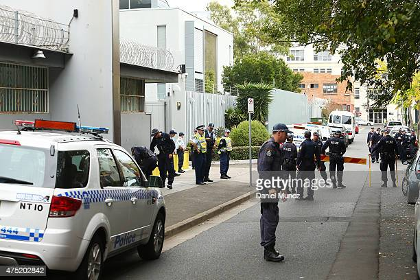 Police is seen before the start of an anti-Chinese foreign investment protest outside the Chinese Consulate on May 30, 2015 in Sydney, Australia. The...