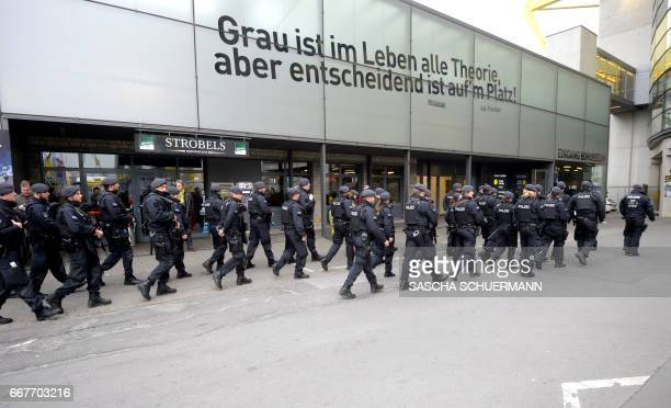 Police is seen outside the stadium prior to the UEFA Champions League 1st leg quarterfinal football match BVB Borussia Dortmund v Monaco in Dortmund...