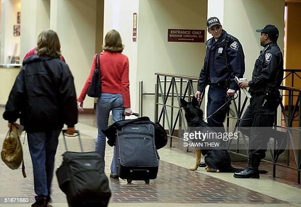 A police K9 patrol stands by as Amtrak travelers walk through Union Station in Washington DC 25 October 2002 Security at Amtrak stations has been...