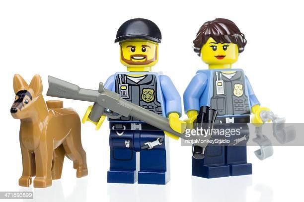 police k-9 unit lego mini figures - like button stockfoto's en -beelden
