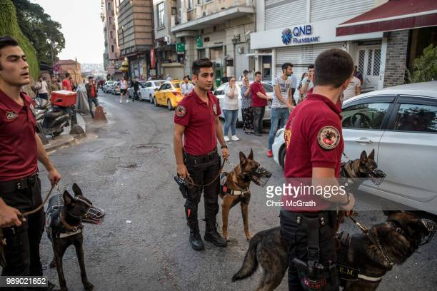 Police K9 units stand guard at the top of a street after dispersing LGBT supporters on July 1 2018 in Istanbul Turkey For the fourth year the 2018...