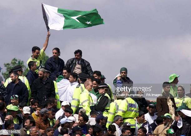 Police keep a close eye on Pakistani and India supporters during the Super Six Cricket World Cup 1999 match at Old Trafford