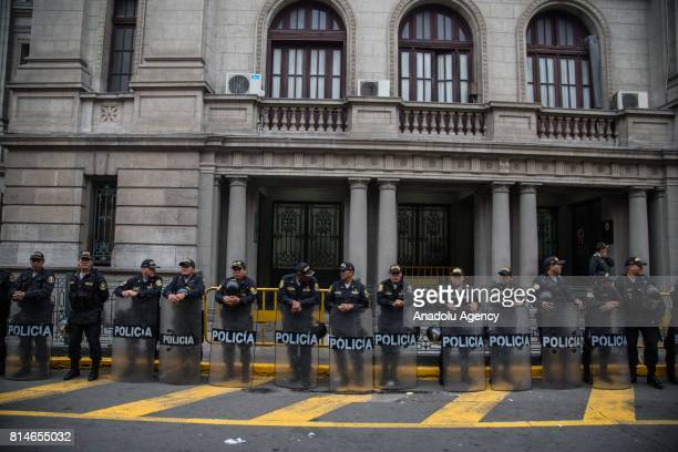 Police keep a security perimeter during the transportation of former Peruvian President Ollanta Humala while and his wife Nadine Heredia toward the...