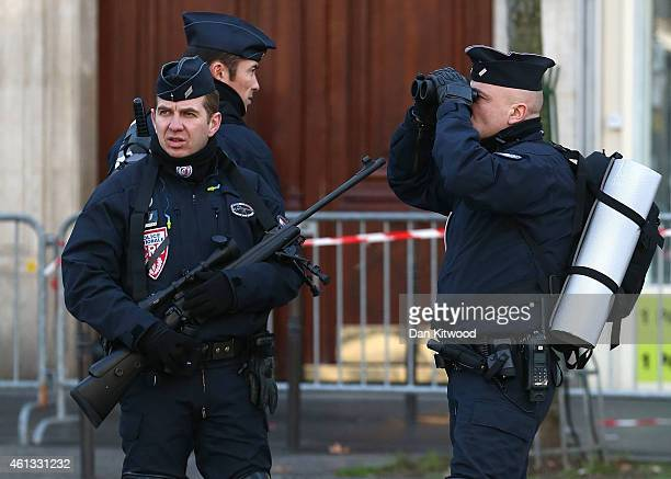 Police keep a watch over Place de la Republique prior to a mass unity rally to be held in Paris following the recent terrorist attacks on January 11...