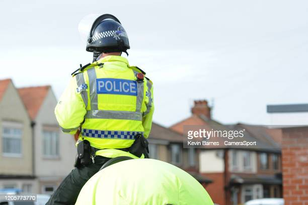 Police keep a watchful eye during the prematch buildup during the Sky Bet Leauge One match between Fleetwood Town and Blackpool at Highbury Stadium...