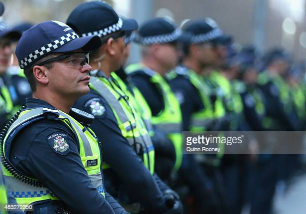 Police keep an eye on proetestors at Melbourne City Square on August 7 2015 in Melbourne Australia The grassroots rally was organised by 'No Room for...