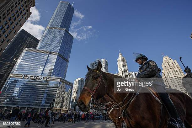 Police keep an eye on protestors outside of Trump Tower on January 21 2017 in Chicago Illinois Tens of thousands of demonstrators took to the streets...