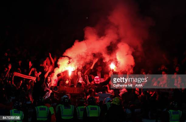 Police keep an eye on the FC Koln fans as they light flares during the UEFA Europa League group H match between Arsenal FC and 1 FC Koeln at Emirates...