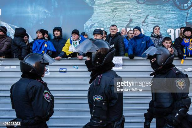 Police keep antigovernment protesters separate from a progovernment rally on December 14 2013 in Kiev Ukraine Thousands of people have been...