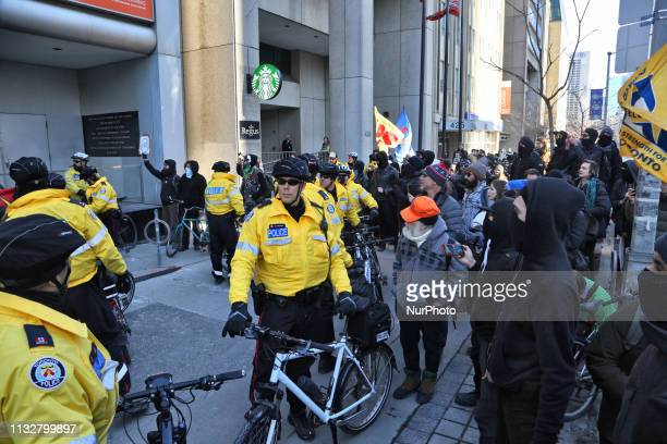 Police keep antiMuslim antirefugee protesters and counter protesters apart during ProMuslim and AntiMuslim rallies held in Toronto Ontario Canada on...
