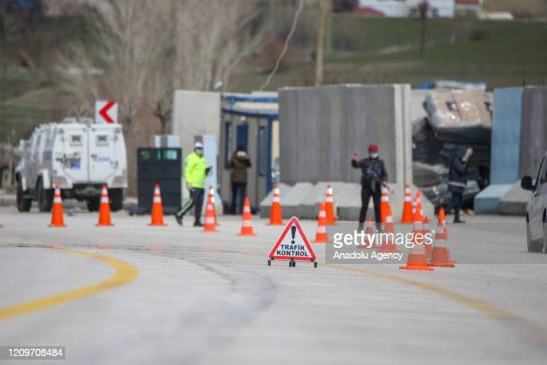 Police keep guard at the city's entrance after a two-day curfew imposed to stem the spread of coronavirus in Van, Turkey on April 12, 2020. Turkey...