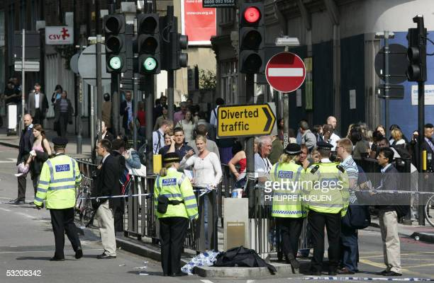 Police keep pedestrians away from Kings Cross Station in London after a bomb exploded on a subway train 07 July 2005 Explosions ripped through three...