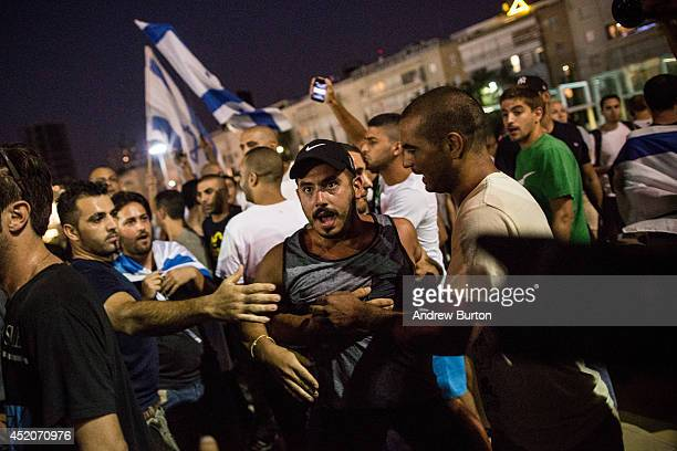 Police keep right-wing supporters of Israel seperated from left-wing protesters during a rally held by the left-wing calling for an end of the...