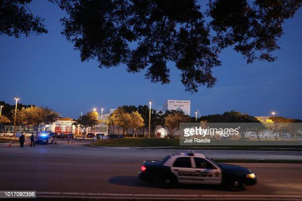 Police keep the campus secure as students arrive at Marjory Stoneman Douglas High School on the first day of school on August 15 2018 in Parkland...