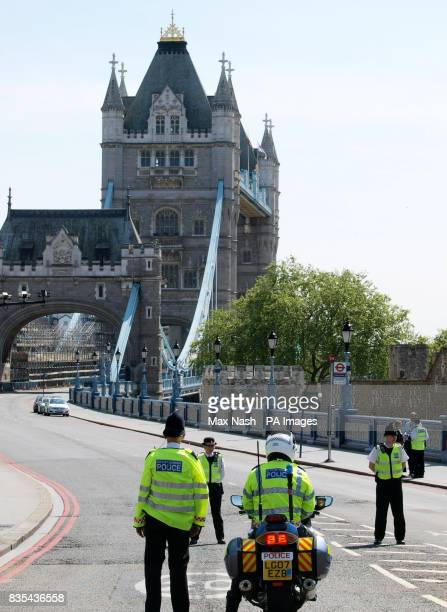 Police keep the road on London's Tower Bridge closed after an elevator accident in the north tower of the structure which left six people injured
