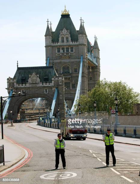 Police keep the road on London's Tower Bridge closed as a fire engine leaves the scene of an elevator accident in the north tower of the structure...