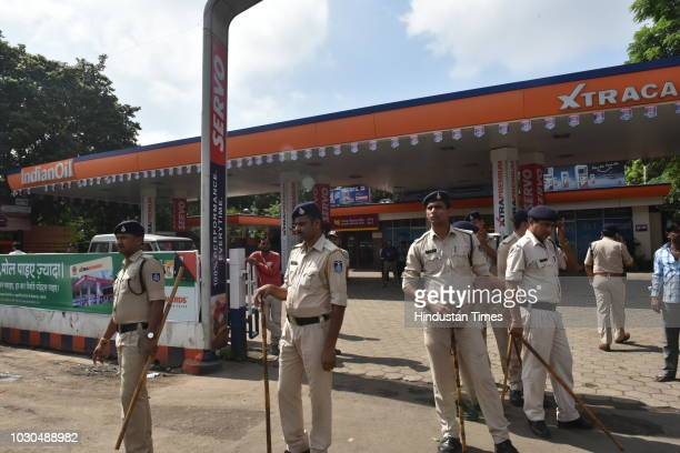Police keep vigil during Bharat Bandh called by Congress to protest against fuel price hike at at Durga Petrol pump, in Char Imli on September 10,...