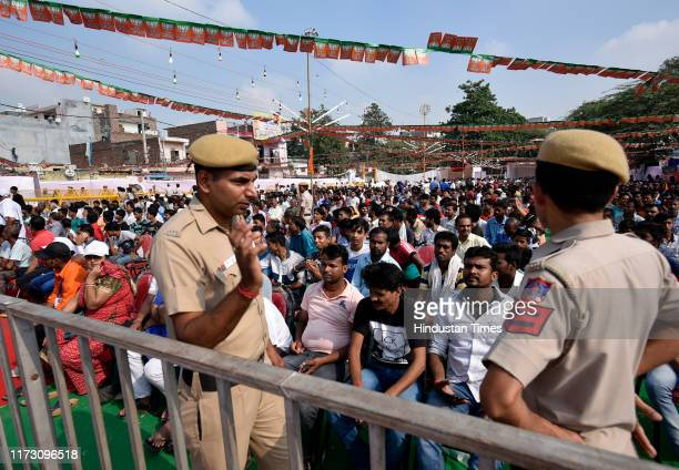 Police keep vigil while supporters listen to Union Home Minister and BJP President Amit Shah during Gandhi Sankalp Yatra on the occasion of the 150th...